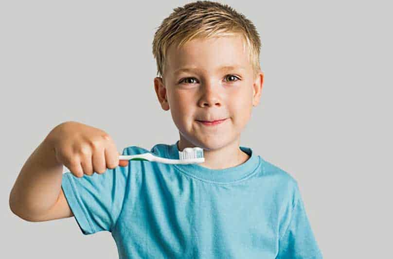 A A Child Brushing His Teeth