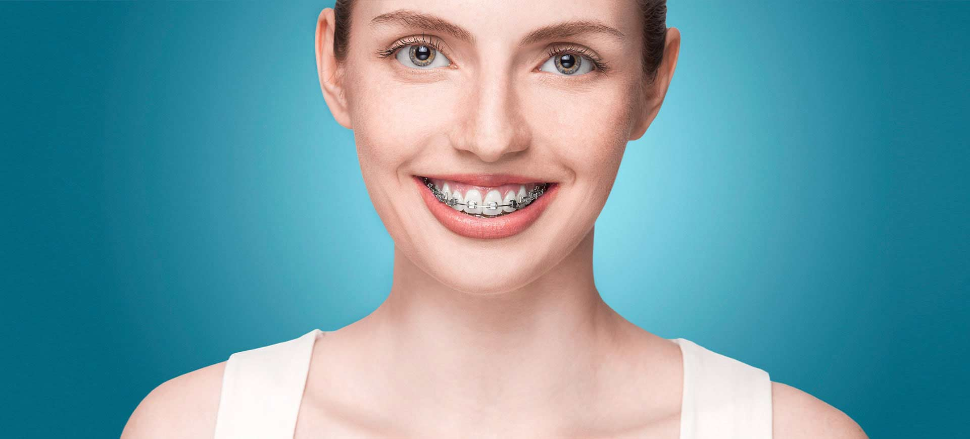 Woman smiling with metal braces