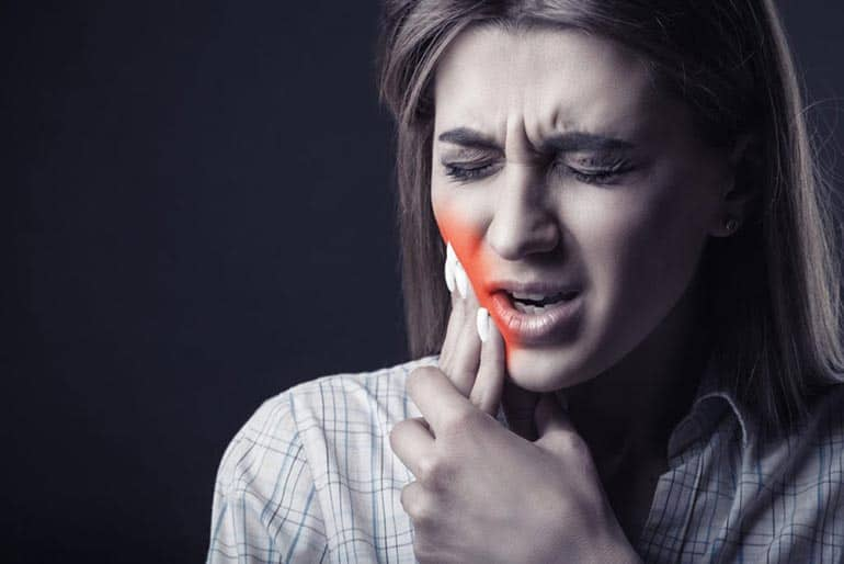 Woman with hard toothache