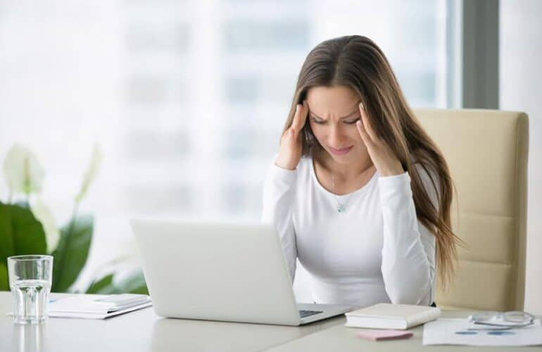Woman with stress and anxiety at work