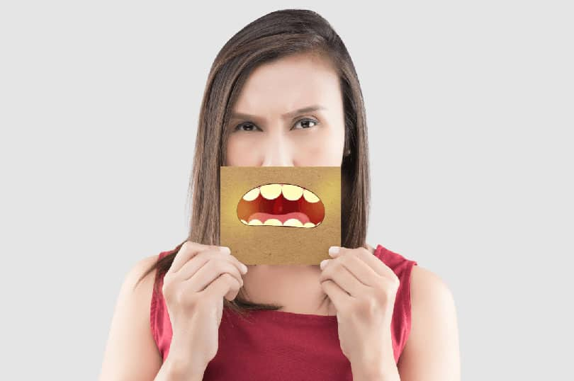 Woman showing unpleasant mouth image