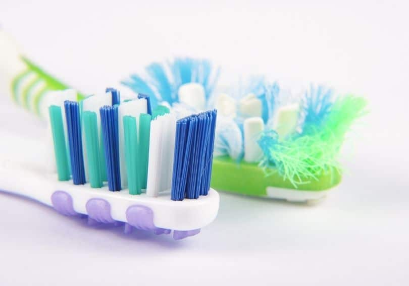 A used and new toothbrush