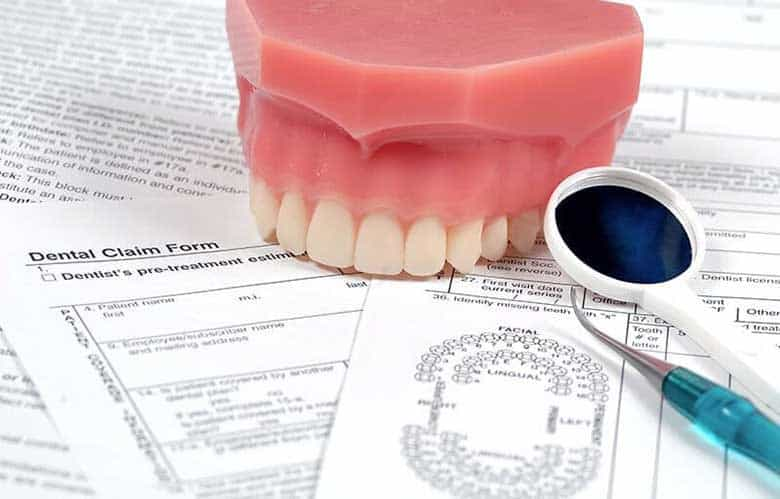 A dentures model on the insurance papers