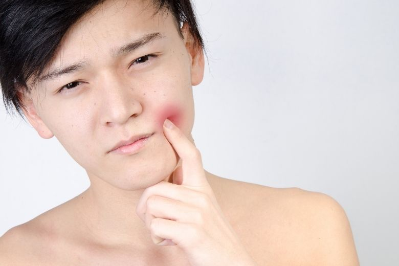 A young boy has a wisdom toothache problem