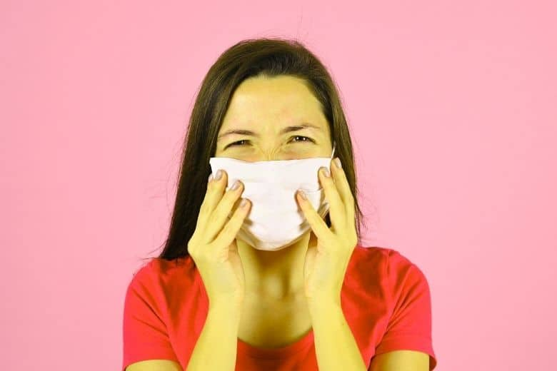 a woman has bad breath under her mask